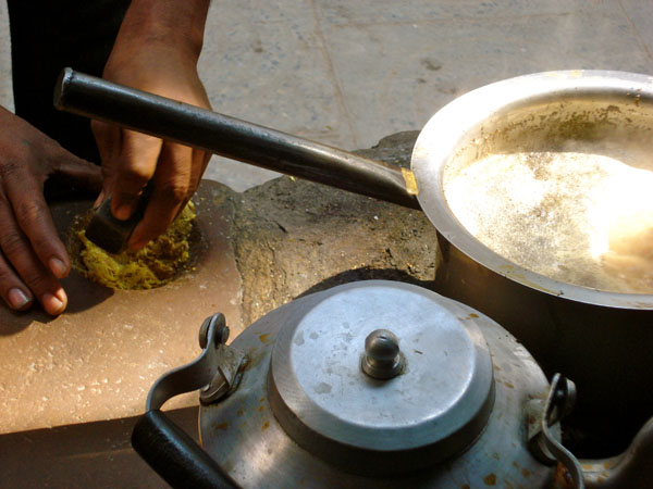 India, street vendor, grinding ginger