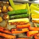 Turning vegetables during roasting